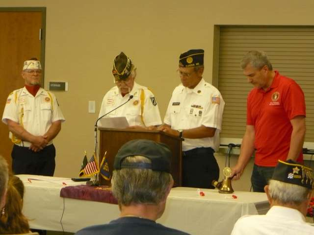 L to right: VFW member Chris Weber, Rich Sax, Mark Schmiedeskamp and Rep Kirk Matthews reading off the names of members who have passed.