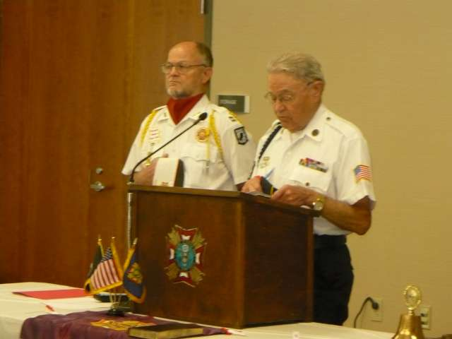 VFW member Chris Weber and AL Post 177 Chaplain Bud Lowe offering a prayer for our departed members.