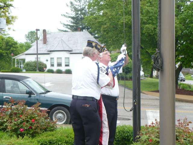 Post 177 Color Guard Raising the Flag at Marine Benefit